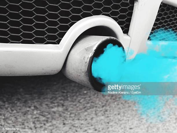 Exhaust Pipe Of Car Emitting Blue Smoke