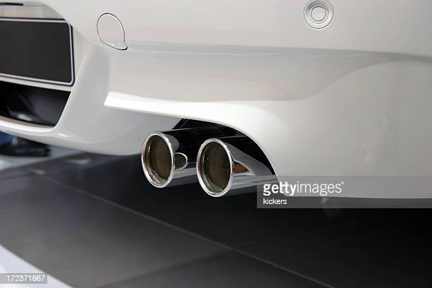 Exhaust pipe of white sports car
