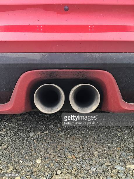 Exhaust Pipes Of Red Car On Street