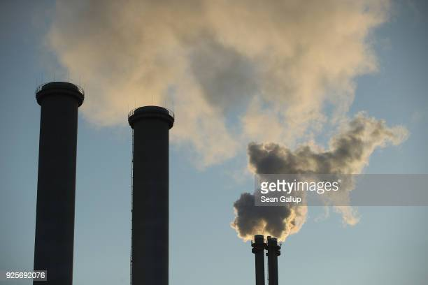 Exhaust rises from the smokestack of a natural gasburning power and heating plant on February 28 2018 in Berlin Germany The German government has set...