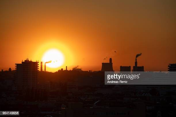 Exhaust rises from the smokestack of a natural gasburning power and heating plant during sunset on April 30 2018 in Berlin Germany