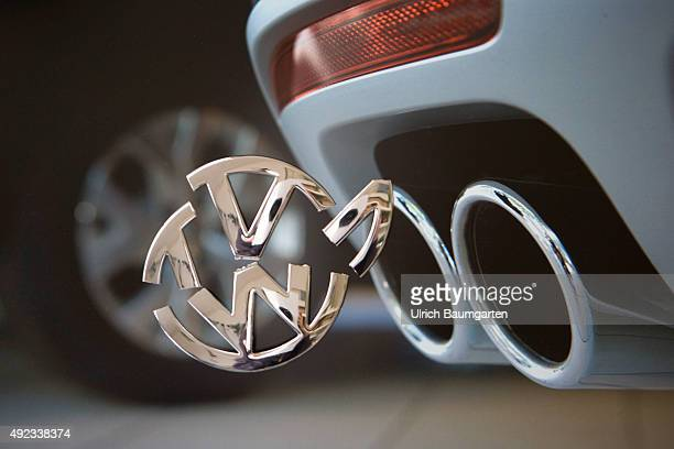 Exhaust scandal at Volkswagen Our picture shows the exhaust pipes of a VW car and a broken VW symbol