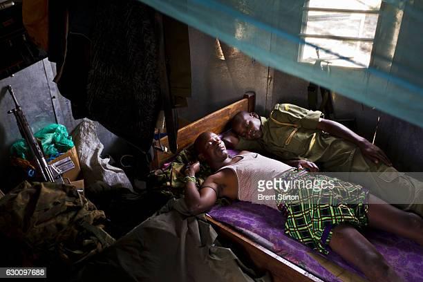 Exhausted antipoaching team members sleep after an allnighter on Ol Pejeta Conservancy in Kenya on July 13 2011 The Ol Pejeta Conservancy is an...