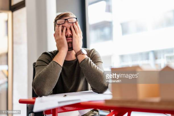 exhausted architect in office - jet lag stock pictures, royalty-free photos & images
