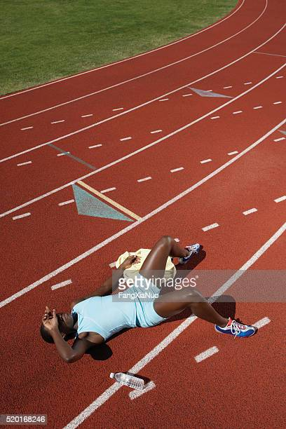 Exhausted athlete on track