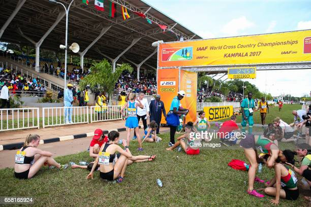 exhausted athletes at the finish line during the U20 women race of the 2017 Kampala IAAF World Cross Country Championships on March 26 2017 in...