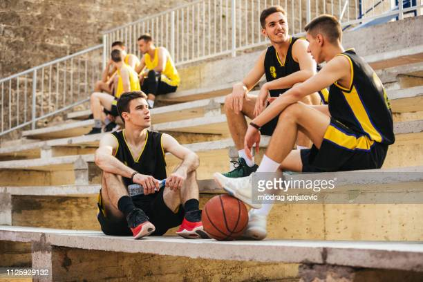exhausted basketball players resting - sporting term stock pictures, royalty-free photos & images