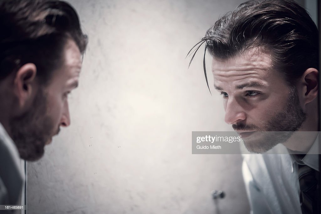 Exhausted business man in hotel bath room. : Stock Photo