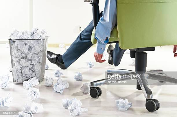 exhausted businessman at the office, many crumpled paper balls - large group of objects stock pictures, royalty-free photos & images