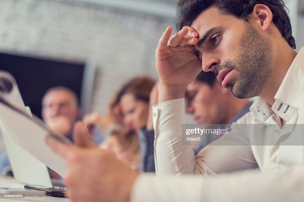 Exhausted businessman in the office. : Stock Photo