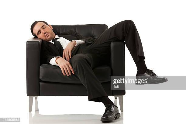 Exhausted businessman on an armchair