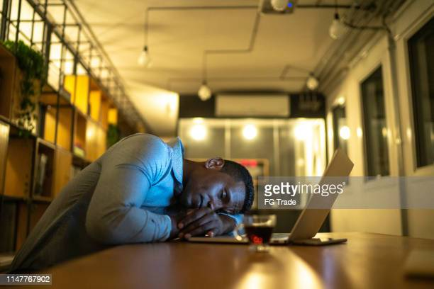 exhausted businessman resting in his desk - struggle stock pictures, royalty-free photos & images