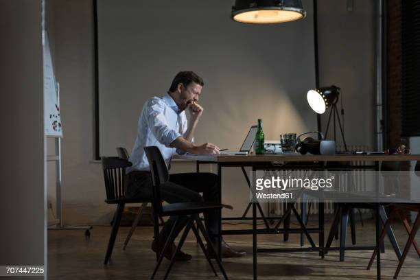 Exhausted businessman working late in office
