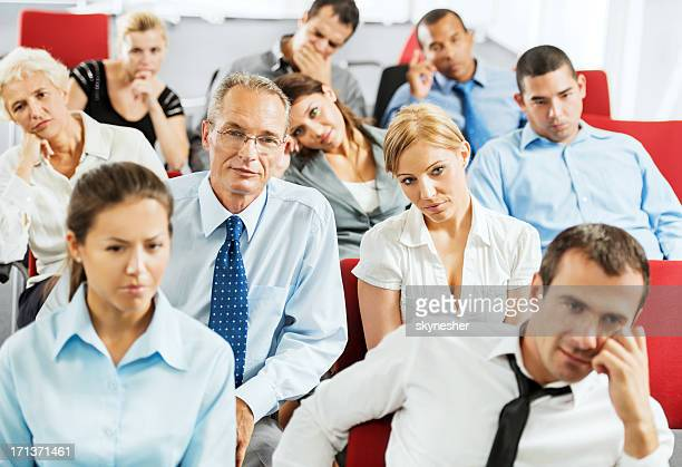 Exhausted businesspeople on a seminar