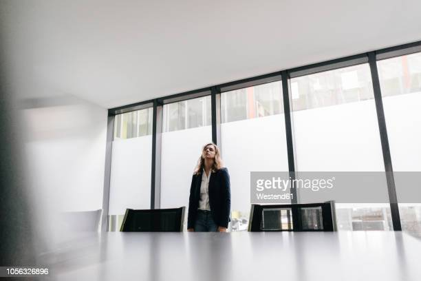 Exhausted businesswoman in conference room