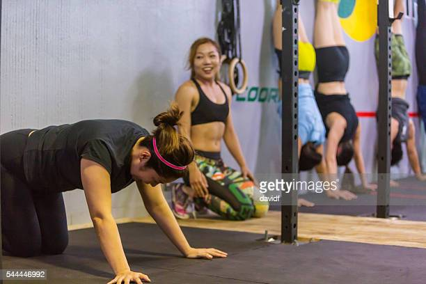 exhausted cross training athletes rest after a weightlifting workout - circuit training stock photos and pictures