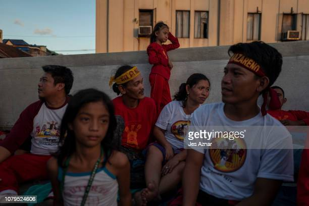 Exhausted devotees taking a rest or sleep before going in again to pull the ropes of the Black Nazarene on January 9 2019 in Manila Philippines The...