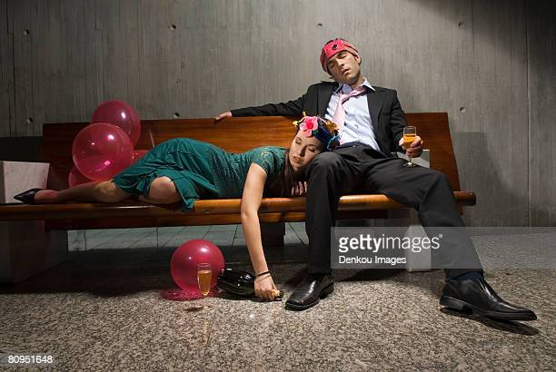 exhausted drunk couple passed out from partying - work party stock pictures, royalty-free photos & images