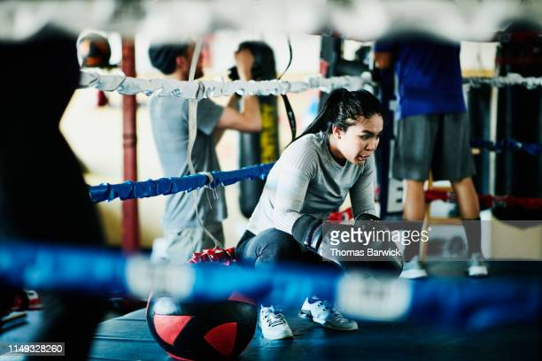 exhausted female boxer resting after workout in boxing gym - philippine independence day stock pictures, royalty-free photos & images