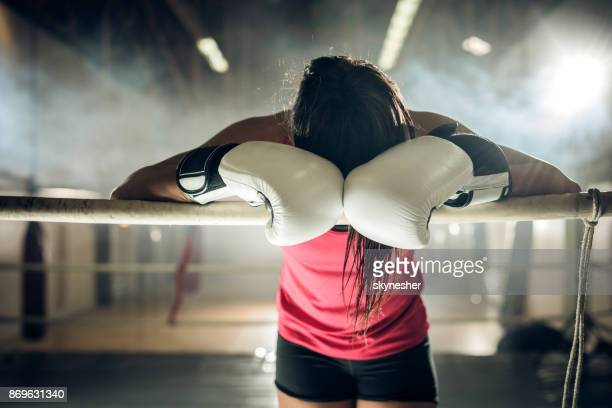 exhausted female boxer with obscured face taking a break in a ring. - obscured face stock pictures, royalty-free photos & images