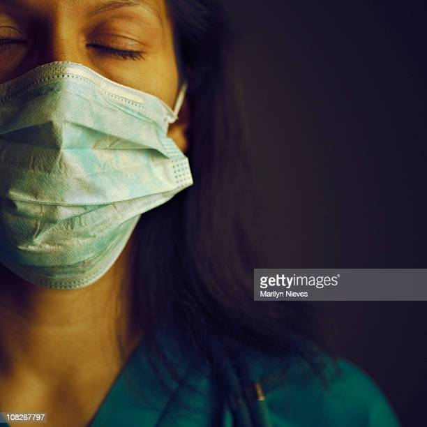 exhausted female doctor - fine art portrait stock pictures, royalty-free photos & images