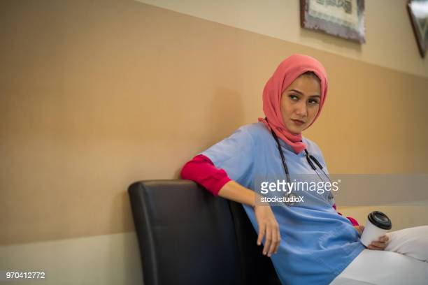 exhausted female muslim doctor taking a break - veil stock pictures, royalty-free photos & images