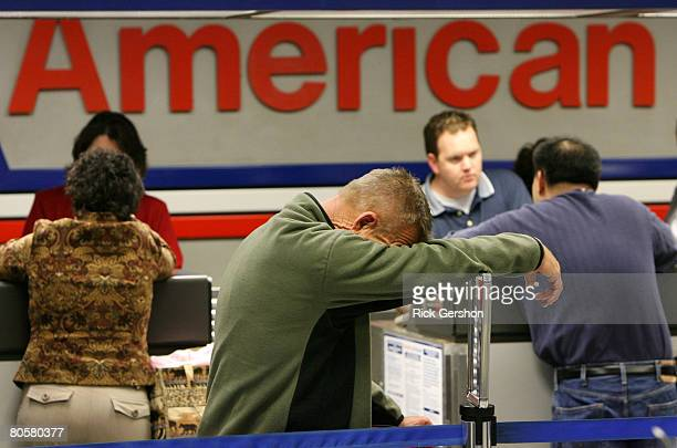 Exhausted from traveling Johnny Sigmon waits in line after his American Airlines flight to Las Vegas was canceled April 9, 2008 at the Dallas Fort...