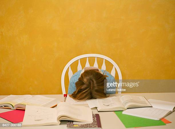 exhausted girl with homework - bad student stock pictures, royalty-free photos & images