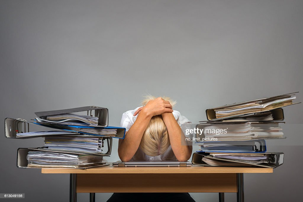 exhausted in office : Stock Photo
