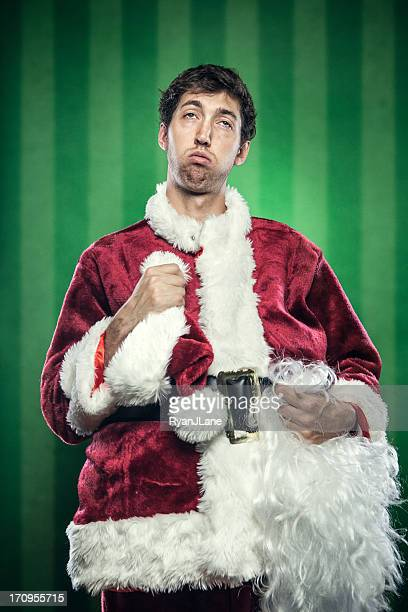 Exhausted Man in Santa Claus Suit