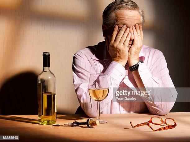 exhausted man with wine - alcoholismo fotografías e imágenes de stock