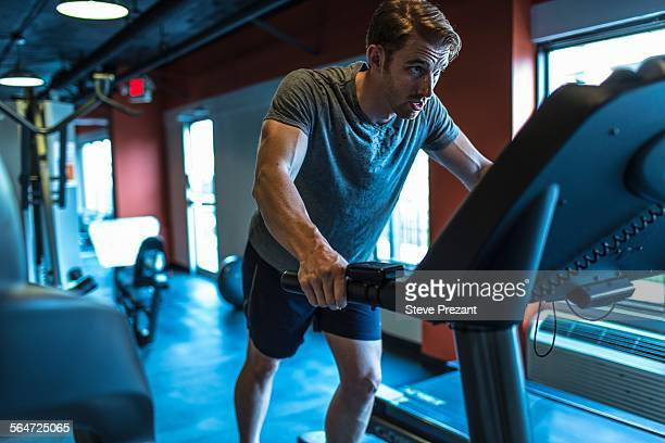 exhausted mid adult man on gym treadmill - treadmill stock pictures, royalty-free photos & images