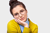 exhausted pretty brunette woman bun casual