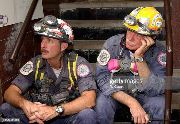 Exhausted rescue workers take a break during World Trade Center Terrorist Attack - Day 14 at Lower Manhattan in New York City, New York, United...