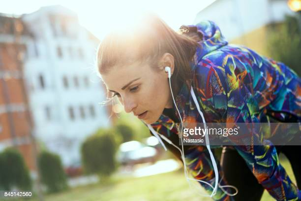 exhausted runner resting - hot body girls stock photos and pictures