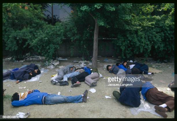 Exhausted students sleep on the ground during a hunger strike in Beijing's Tiananmen Square In the spring of 1989 students and citizens held massive...