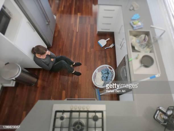 exhausted upset housewife at home kitchen - rafael ben ari stock-fotos und bilder