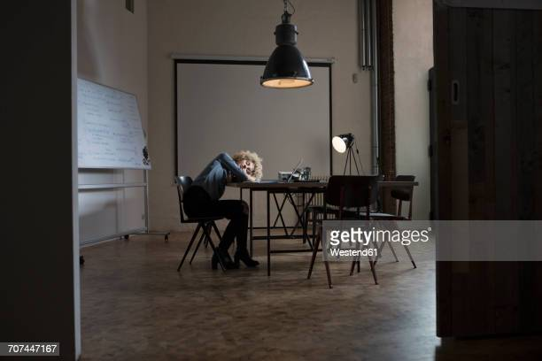 Exhausted woman in boardroom