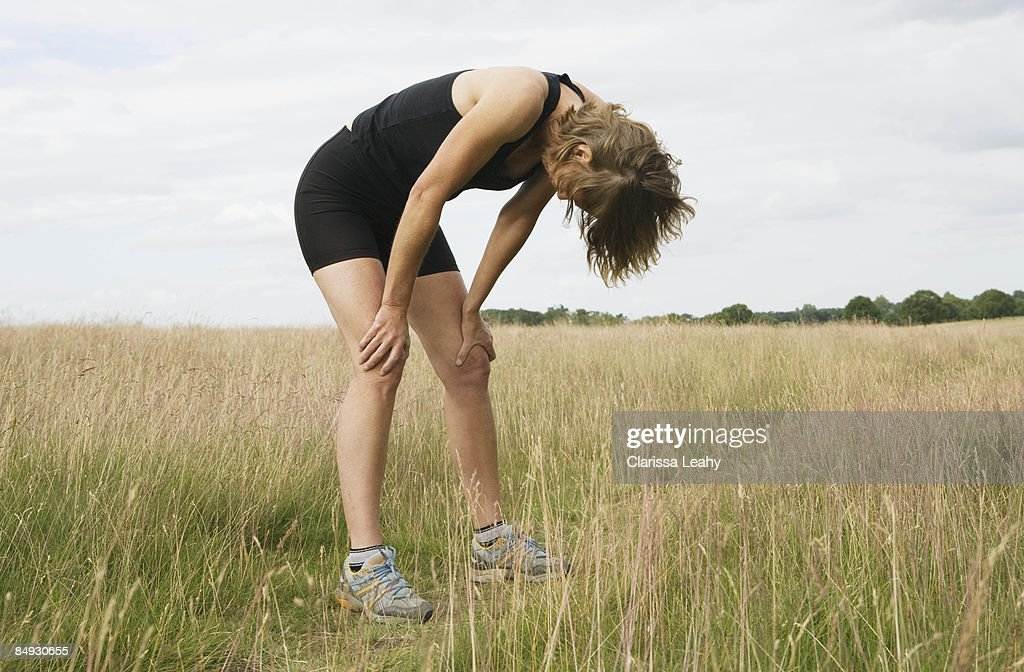 Exhausted woman runner resting : Stock Photo