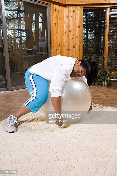 Exhausted woman sleeping on an exercise ball
