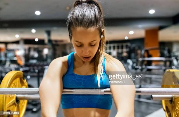 Exhausted young woman after work out in the gym