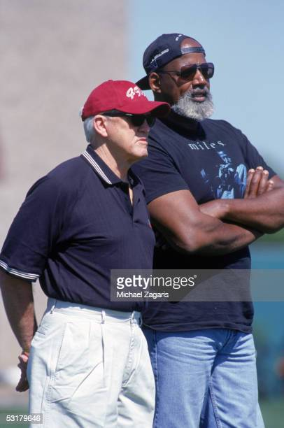 Exhead coach Bill Walsh and Dr Harry Edwards a consultant for the San Francisco 49ers watches the action during the April 231999 San Francisco 49ers...
