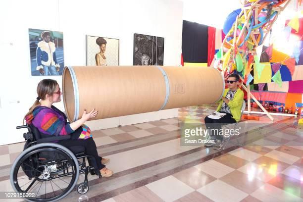 Exhibit guests interact with an art installation by KellyAnn Lindo at PRIZM Art Fair as part of the 2018 Art Basel Miami Beach art fair on December 7...