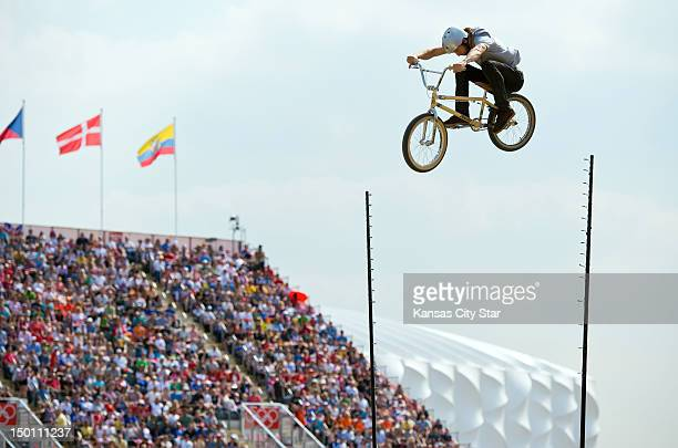 Exhibition BMX riders perform aerial stunts between Olympic competition at the BMX Track in Olympic Park during the 2012 Summer Olympic Games in...