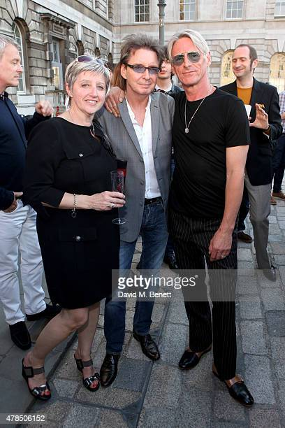 Exhibition Curator Nicky Weller musicians Bruce Foxton and Paul Weller of The Jam attend the private view of The Jam About the Young Idea at Somerset...