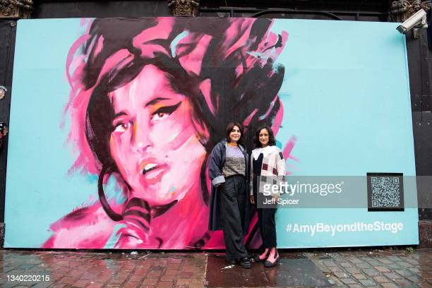 Exhibition curator Priya Khanchandani and Naomi Parry attend a mural unveiling to mark the Design Museum's Amy Winehouse exhibition announcement in...