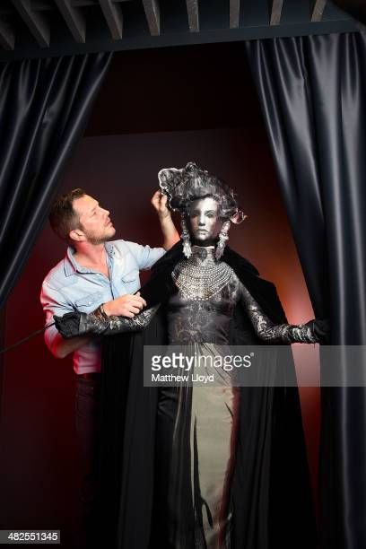 Exhibition Curator ThierryMaxime Loriot makes final preparations to Jean Paul Gaultier couture at the Barbican Centre on April 3 2014 in London...