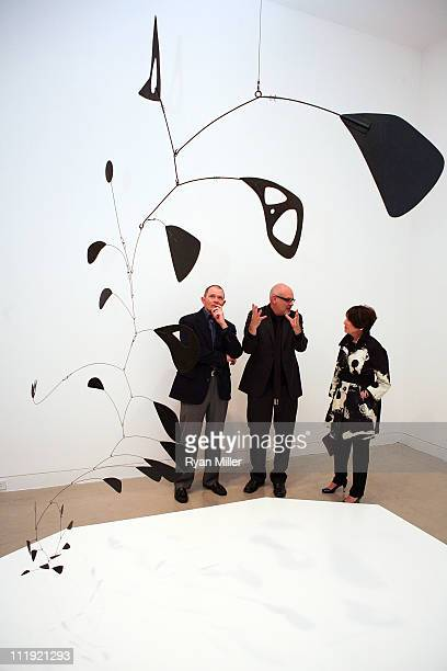 Exhibition donor James Muzzy OCMA Director Dennis Szakacs and exhibition donor Pamela Muzzy look through the exhibit during the Alexander Calder and...