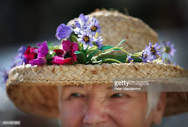 Exhibitor Penny Cunnington wears a floral display in her hat the Royal Horticultural Society Flower Show at Wisley Gardens on September 2 2014 in...