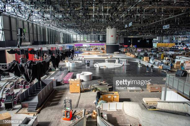 Exhibitors have to dismantle their displays after cancellation of the Geneva Auto Show on February 28 2020 in Geneva Switzerland Swiss authorities...